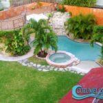 Pool with Waterfall (it has a full badroom and changing area below the deck) / Piscina con Cascada (con baño completo y area par acambiarse bajo la terraza)