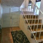 12.- CASA TOM - Stairs and storage area